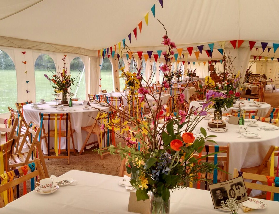 Flat ivory lining, Bold colours bunting, 30x100ft Modular frame tent,