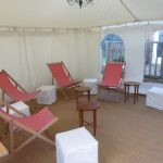 Deckchairs, padded stools and teeny tables for hire