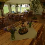 varnished trestle tables, flat ivory interior, for hire